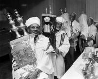 Rabbis processing the Torah during Simchat Torah
